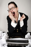 Writers Block. Retro business woman with vintage typewriter yawning Royalty Free Stock Images