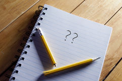 Writers block. Questions mark and broken pencil on top of a note pad Royalty Free Stock Photo