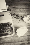 Writers block. Rumpled paper around a typewriter, a concept for  a creativity block Royalty Free Stock Image