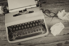 Writers block still life. Rumpled paper around a typewriter, a concept for  a creativity block Stock Image