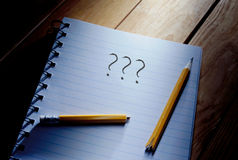 Writers block. Three questions mark and broken pencil on top of a note pad Royalty Free Stock Photo