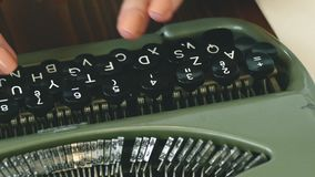 Writers hands on typewriter in white room stock footage