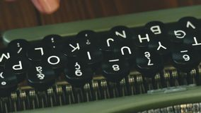 Writers hands on typewriter in white room stock video
