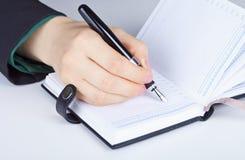 Writes in diary Royalty Free Stock Photos