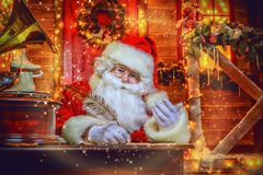 Writes long letters. Santa Claus is preparing for Christmas. He writes letters. House of Santa Claus. Christmas decoration royalty free stock photography