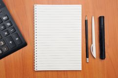 Writes in a notebook around royalty free stock images