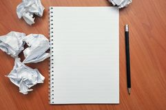 Writes in a notebook around a crumpled paper Royalty Free Stock Images