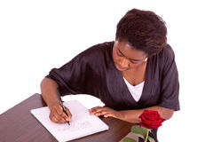Writing. A young woman writes a letter royalty free stock images