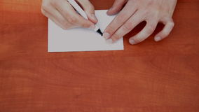 Writing 150%. On a piece of notepaper stock footage