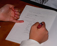 Writing. Two student hands writing notice during a lecture...in Japan Royalty Free Stock Photography