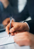 Writing. Close-up picture of businessman's hand writing in the document Stock Photography