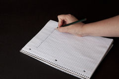 Writing. With a pencil in a notebook royalty free stock image