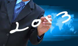 Writing 2013. A businessman hand writing 2013 royalty free stock images