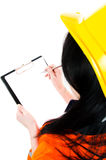 Writing... Engineer woman  taking notes in her clipboard - place for own text Stock Photo