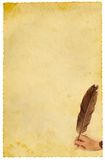 Writing. Hand writing with feather on old yellow paper Stock Image