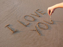 Writing. I love you on the sand stock photography