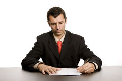 Writing. Young business man writing on a desk Royalty Free Stock Photo