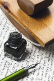 Writing. Vintage writing tools - nib, ink bottle  and an ink dryer- on a letter Royalty Free Stock Photo