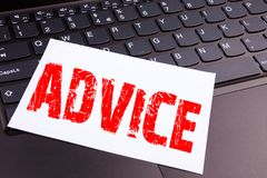 Writing Advice text made in the office close-up on laptop computer keyboard. Business concept for Suggestion guidance concept Work. Shop on the black background Stock Image