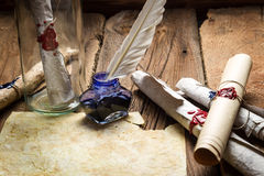 Writing ancient feather letter and send it in a bottle Stock Image