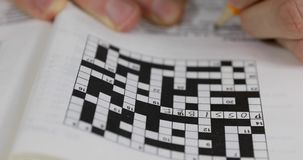 Writing answer in crossword puzzle stock video