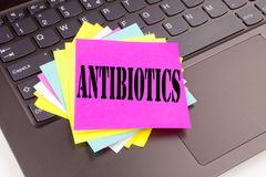 Writing Antibiotics text made in the office close-up on laptop computer keyboard. Business concept for Health care Prescription dr Stock Image