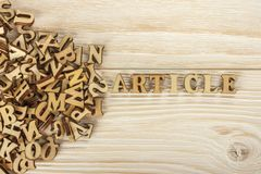 Writing articles. From the pile of letters to create the text for the press. Wooden letters on a wooden background. The view from. Writing articles. From the royalty free stock photos