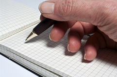 Writing with a ballpoint pen Stock Photo