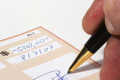 Writing a bank check. Note: check, numbers and signature are fictitious Stock Images