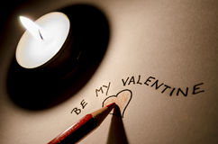 Writing a Be my Valentine note Royalty Free Stock Image