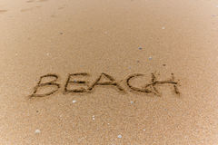 Writing on the beach. Writing in the sand on the beach Stock Photography