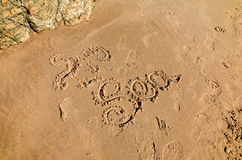 Writing on beach sand. Saying Song of the Sea Royalty Free Stock Photos