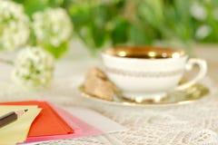 Writing belongings on a defocused breakfast table Royalty Free Stock Photos