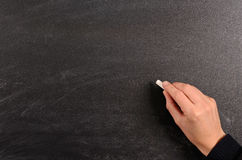 Writing on a blackboard Royalty Free Stock Photo