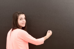 Writing on a blackboard. Teacher writing on a blackboard Stock Photography