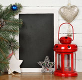 Writing board and Christmas decorations Royalty Free Stock Image