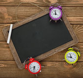 Writing board and clock Royalty Free Stock Photography