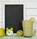 Writing board and fruit smoothies Royalty Free Stock Photo