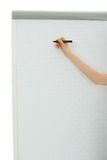 Writing on a board with a marker. Arm of a business person writing on a board with a marker. Isolated on white background Royalty Free Stock Image