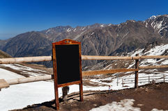 Writing board in the mountains Stock Image