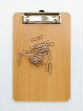 Writing board and  paper clip. For office Stock Images