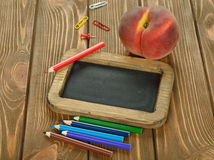 Writing board and pencils Royalty Free Stock Images