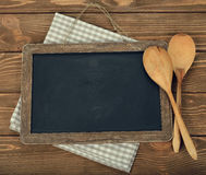 Writing board and spoon Royalty Free Stock Images