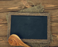 Writing board and spoon Royalty Free Stock Image