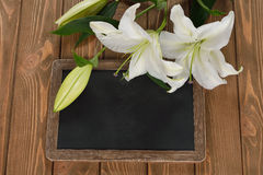 Writing board and a white lily Royalty Free Stock Photo