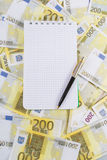 Writing-book for notes. With pen on banknotes 200 euros Stock Photo