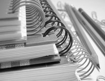Writing-books. Three writing-books and pencils in black and white Royalty Free Stock Image