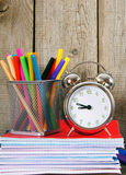 Writing-books, an alarm clock and school tools. Royalty Free Stock Photo