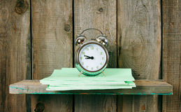 Writing-books and an alarm clock . Royalty Free Stock Images