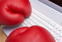Writing with boxing gloves on a keyboard Stock Photography
